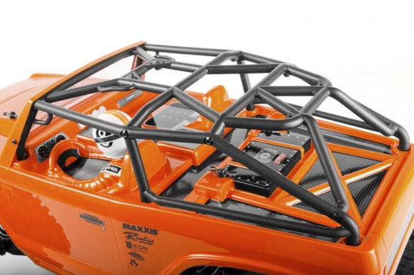 DOVE-TAIL CAGE The universal dove-tailed bolt-in cage is made to fit rig bodies modified for maximum clearance. This cage works with AX04038 Jeep® Wrangler Rock Racer Body and AX04039 AX10 Deadbolt Body.