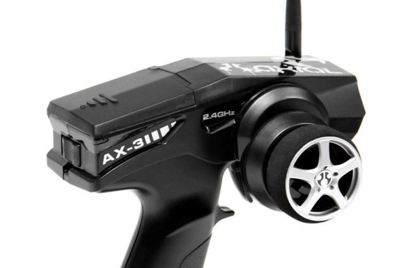 2.4GHz RADIO FOR WORRY-FREE DRIVING The AX-3 2.4GHz transmitter is a two channel, pistol grip radio with servo reversing switches for steering and throttle, trim dials for fine tuning steering and throttle centers. The battery indicator light also lets you know when your transmitter batteries run low.