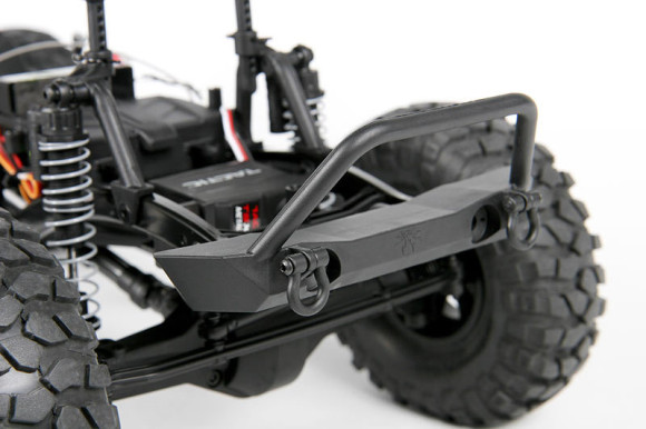 POISON SPYDER ROCK BRAWLER BUMPER Officially Licensed Poison Spyder Rock Brawler front bumper adds realism and functionality. The bumper features functional D-Rings for realistic recoveries, mounting holes for LED lights and an excellent approach angle to tackle extreme terrain. * LED lights not included - optional Axial LED light systems: AX24251 Axial NVS - Night Visions System, AX24257 Simple LED Controller. You can find more information about light sets and other accessories on our website.