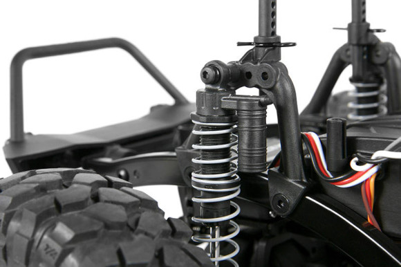 ADJUSTABLE COILOVER SHOCKS The shocks on the SCX10 feature dual rate springs which help deliver maximum off-road performance. They are oil filled shocks which allow you to tune the dampening rate. Shock hoops on the SCX10 frame allow for multiple shock positions for tunable performance. There's also coilover shock reservoirs for realistic scale looks.