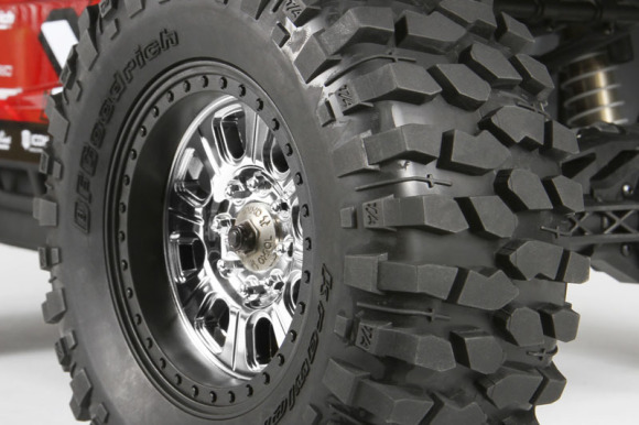 "BFGOODRICH® KRAWLER™ T/A® KX TIRES BFGoodrich has more than three decades of off-road racing commitment under their belt, scoring 23 SCORE Baja 1000 championships and 26 Score Baja 500 championships from 1975 - 2010! In the full-size off-road world, BFGoodrich® Krawler™ T/A® KX tires are the winner of more rock-crawling championships than all other tires combined (Race spec tire, Years 2004 through 2008). The Axial version of this tire captures the same aggressive look and provides awesome performance on a wide variety of surfaces. This is the perfect tire for this style of vehicle due to its high level of performance and diversity. Tires - 74x184mm (2.9x7.25"") BFGoodrich® Tires and KRAWLER™ T/A® Trademarks are used under License from Michelin"